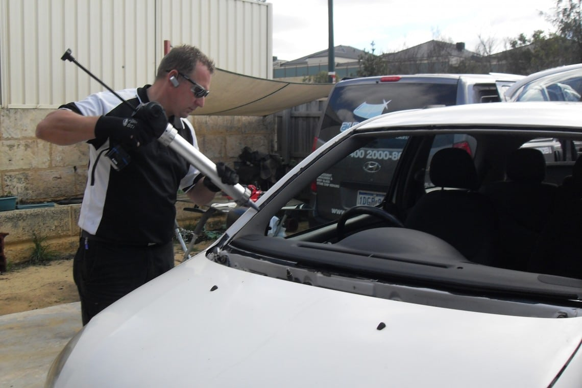 finishing touches to a new windscreen