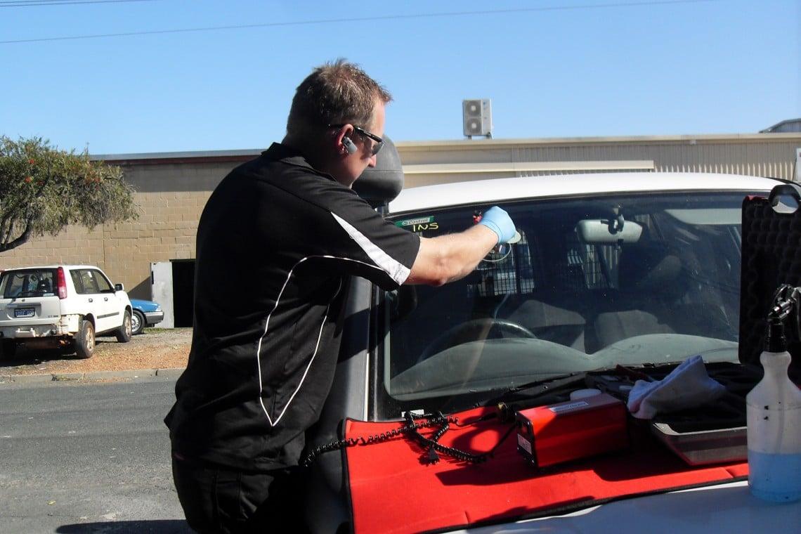 Jason working on a windscreen